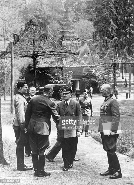 'Führerhauptquatier Wolfsschanze' near Rastenburg in East Prussia Adolf Hitler welcomes General Karl Bodenschatz Hermann Göhringïs liaison officer at...