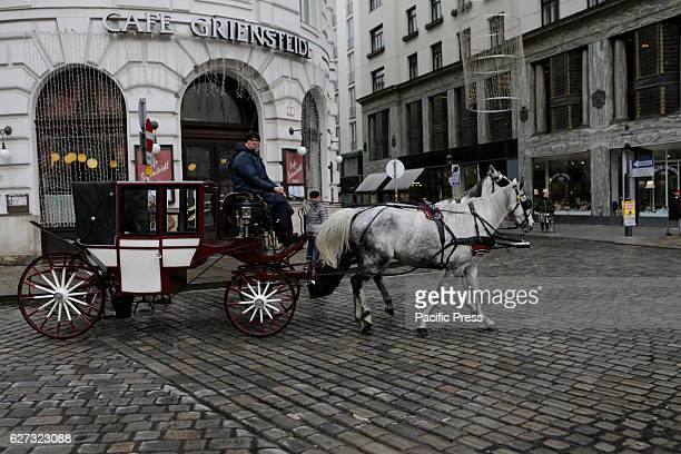 MICHAELERPLATZ VIENNA AUSTRIA A fiacre drives on the Michaelerplatz outside the Hofburg Palace The life in Vienna continues in the normal pace in...