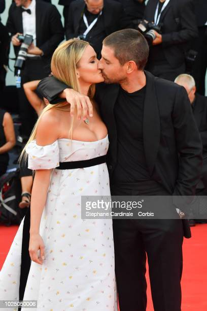 Fiammetta Cicogna and Carl Hirschmann walks the red carpet ahead of the opening ceremony and the 'First Man' screening during the 75th Venice Film...