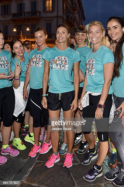 Fiammetta Cicogna Martina Colombari and Federica Fontana compete in We Own The Night Milan Women's 10km Run on May 30 2014 in Milan Italy