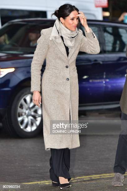 Fiancée of Britain's Prince Harry US actress Meghan Markle arrives to visit Reprezent 1073FM community radio station in Brixton south west London on...