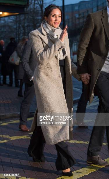 Fiancée of Britain's Prince Harry's US actress Meghan Markle waves to wellwishers as they leave after a visit to Reprezent 1073FM community radio...