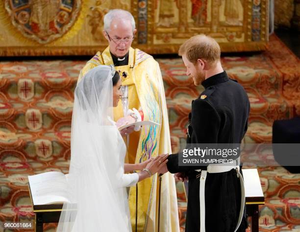 Fiancee of Britain's Prince Harry Meghan Markle and Britain's Prince Harry, Duke of Sussex during their wedding ceremony in St George's Chapel,...