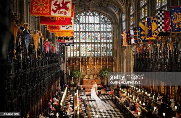 US fiancee of Britain's Prince Harry Meghan Markle and Britain's Prince Harry Duke of Sussex during their wedding ceremony conducted by the...
