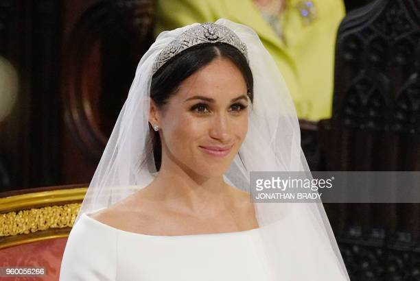 TOPSHOT US fiancee of Britain's Prince Harry Meghan Markle arrives at the High Altar for their wedding ceremony in St George's Chapel Windsor Castle...