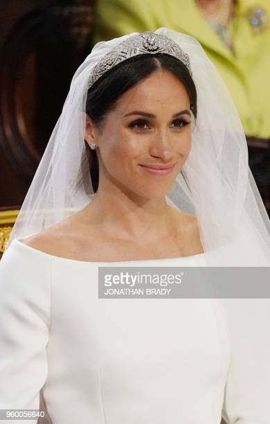 US fiancee of Britain's Prince Harry Meghan Markle arrives at the High Altar for their wedding ceremony in St George's Chapel Windsor Castle in...