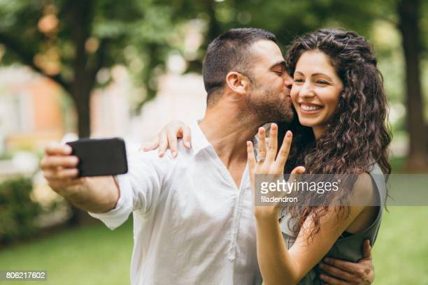 fiances taking a selfie - fiancé stock pictures, royalty-free photos & images