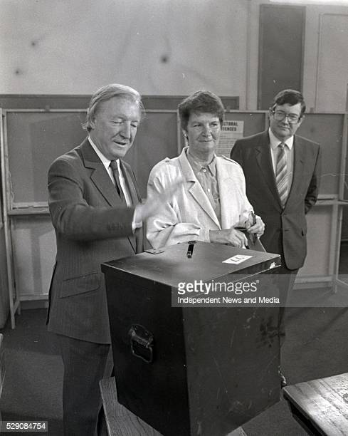 Fianna Fail leader Charles Haughey TD and his wife Maureen cast their votes in the Divorce Referendum at Kinsealy NS looking on is Ray Burke TD...