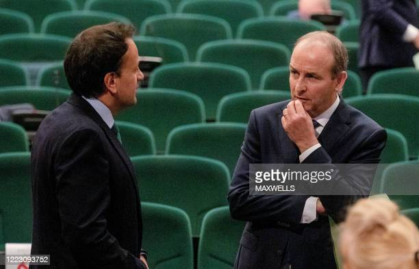 Fianna Fail leader Micheal Martin talks with outgoing Irish prime minister Leo Varadkar inside the Convention Centre Dublin during the 33rd sitting...