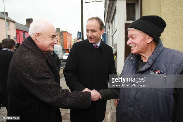 Fianna Fail Leader Micheal Martin with Ned O'Keeffe TD chats to a local on the main street of Fermoy today during his walkabout in his home county of...