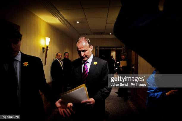 Fianna Fail party leader Micheal Martin leaves the Alexander Hotel in Dublin after a press conference where Mr Martin claimed that a vote to expel...