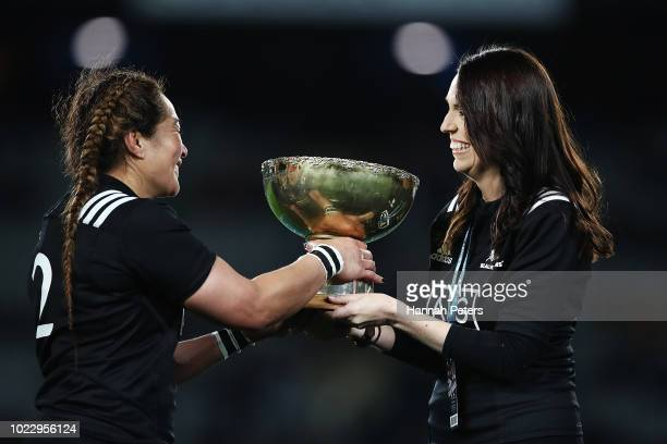 Fiao'o Faamausili is presented the trophy by New Zealand Prime Minister Jacinda Ardern during the International Test match between the New Zealand...