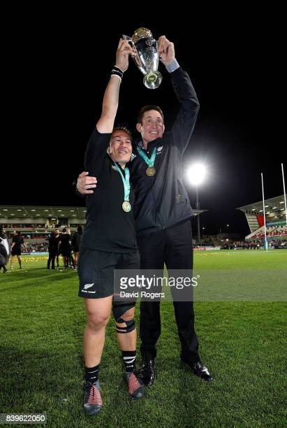 Fiao'o Faamausili of New Zealand and New Zealand Head Coach Brian Smith celebrate with the trophy following the Women's Rugby World Cup 2017 Final...