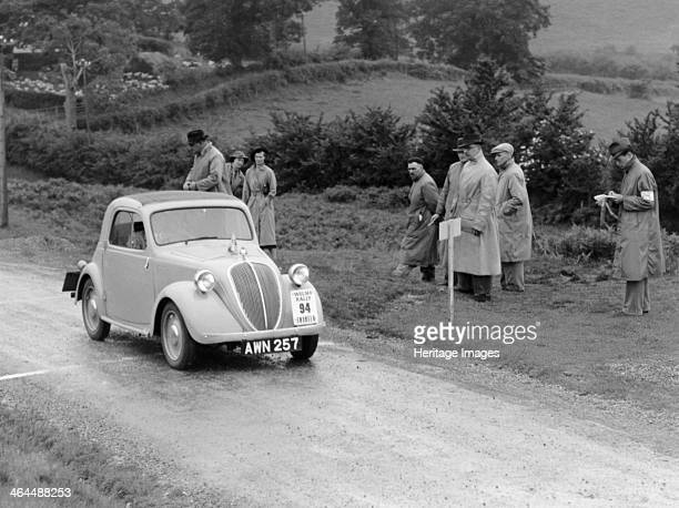 Fiat 500 Coupe competing in the Welsh Rally Officials watch the car pass a checkpoint Launched in 1936 the new 'baby' Fiat the 500 or 'Topolino' was...