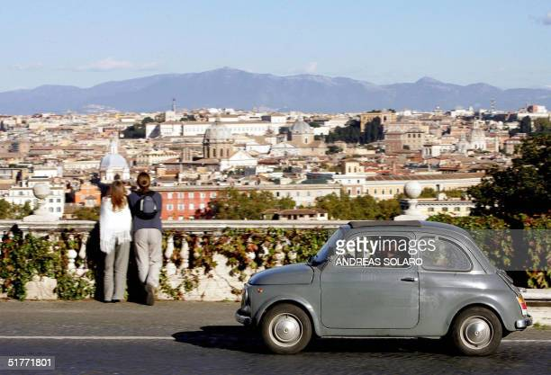 Fiat 500 is driven on the Gianicolo hill traditional Rome's panoramic street 20 November 2004 With more than 600000 Fiat 500 the stubby pugnosed car...
