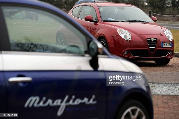 Fiat 500 left and Alfa Romeo Mito automobiles are seen parked at the Mirafiori Motor Village in Turin Italy on Friday Jan 22 2010 Fiat SpA the...