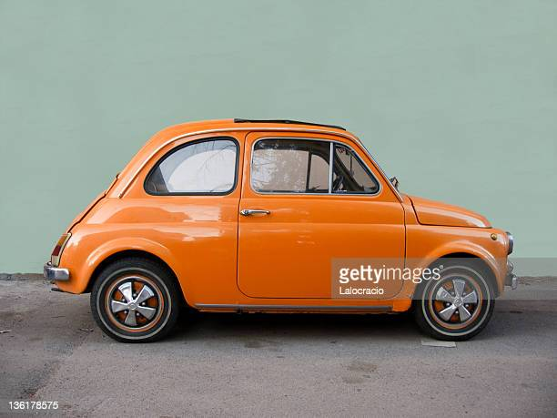 fiat 500 orange. - vintage car stock pictures, royalty-free photos & images