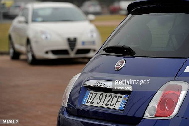 Fiat 500 right and Alfa Romeo Mito automobiles are seen parked at the Mirafiori Motor Village in Turin Italy on Friday Jan 22 2010 Fiat SpA the...