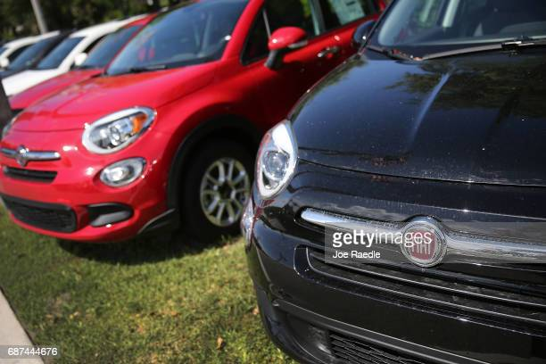 Fiat cars are seen on a sales lot on May 23 2017 in Miami Florida The US government is suing Fiat Chrysler for possibly cheating on emmision controls...