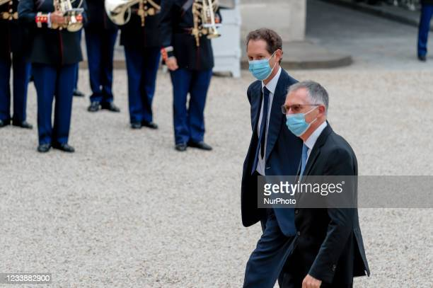 Fiat Chrysler Automobiles Chairman John Elkann and Chairman of the Management Board of PSA group and CEO of Stellantis Carlos Tavares arrive for...