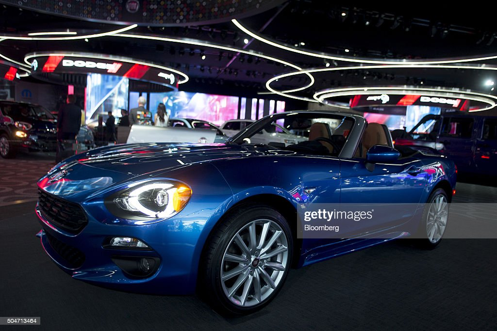 A Fiat Chrysler Automobiles NV 2016 Fiat 124 Spider vehicle sits on display during the 2016 North American International Auto Show (NAIAS) in Detroit, Michigan, U.S., on Tuesday, Jan. 12, 2016. Last year's auto show featured 55 vehicle introductions, a majority of which were worldwide debuts, and was attended by over 5,000 journalists from 60 countries. Photographer: Andrew Harrer/Bloomberg via Getty Images