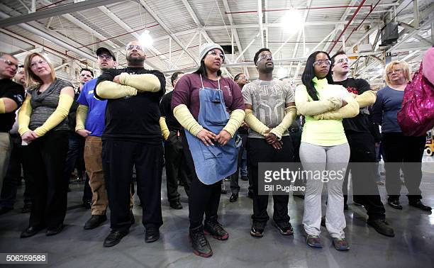 Fiat Chrysler Automobiles US workers attend the dedication of a new $63 million press at the Warren Stamping Plant January 22 2016 in Warren Michigan...