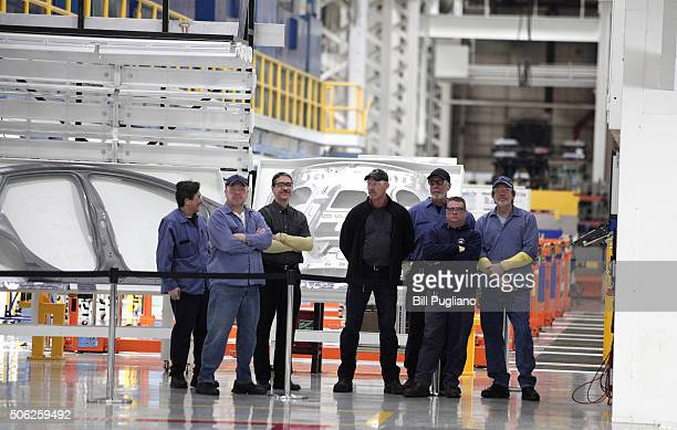 Fiat Chrysler Automobiles US workers watch the dedication of a new $63 million press at the Warren Stamping Plant January 22 2016 in Warren Michigan...