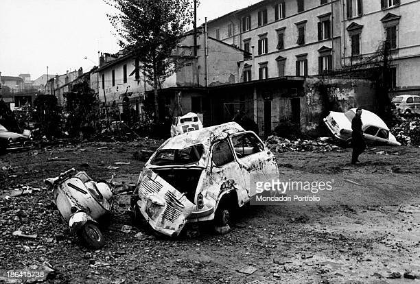 A Fiat Cinquecento car and a Vespa Piaggio scooter two among the symbols of the italian economic boom ruined and abandoned together with other...