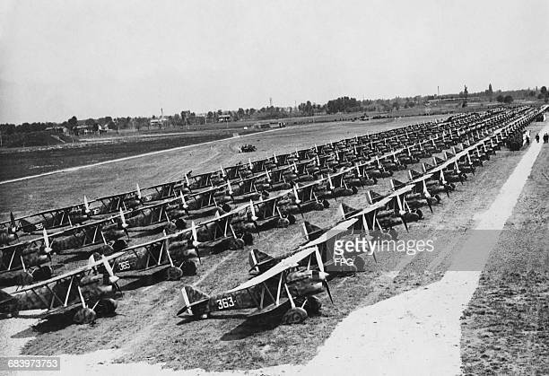 Fiat CR32 biplane fighters of the 363 Squadriglia 53rd Stormo of 150 Gruppa of the Italian Regia Aeronautica are lined up in parade formation at the...
