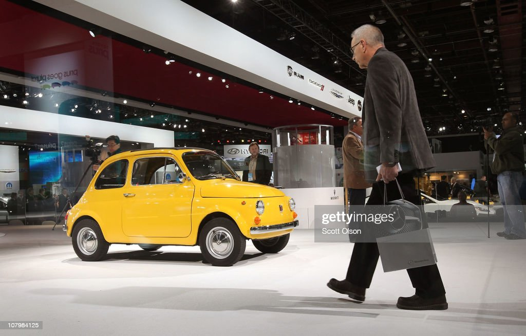 Fiat displays a 1970 Fiat 500 during the press preview of the North American International Auto Show at the Cobo Center on January 11, 2011 in Detroit, Michigan. The show is currently opened only for media previews and opens to the general public January 15-23.