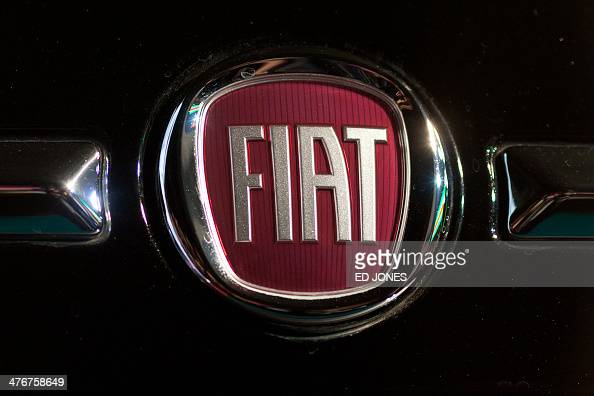 A Fiat Logo Is Displayed On A Gucci Fiat 500 Car At An Unveiling