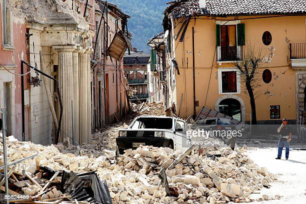 Fiat Panda rests on rubble in a street in the historical town of L'Aquila on April 6, 2009 in L'Aquila, Italy. The 6.3 magnitude earthquake tore...