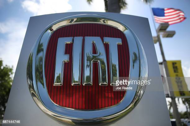 Fiat sign is seen at a dealership on May 23 2017 in Miami Florida The US government is suing Fiat Chrysler for possibly cheating on emmision controls...