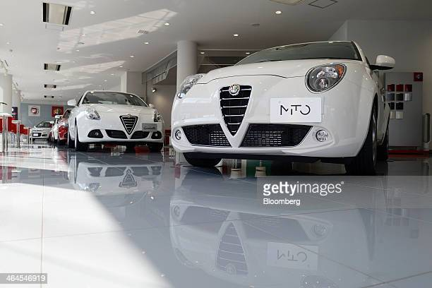 Fiat SpA Alfa Romeo Mito right and Giulietta automobiles stand on display inside a GST Co showroom in Tokyo Japan on Wednesday Jan 22 2014 Fiat which...
