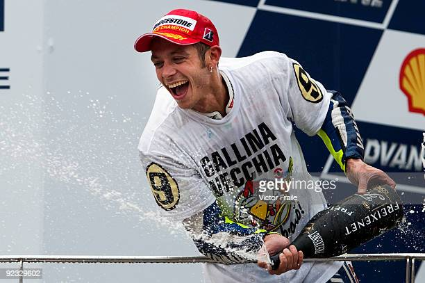 Fiat Yamaha Team rider Valentino Rossi of Italy celebrates after winning his ninth MotoGP World Championship with his third place in the Malaysian...