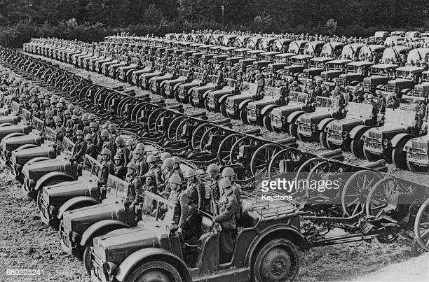 FiatSPA TL37 4×4 Artillery Tractors towing field guns of the Royal Italian Army line up on parade on 13 October1940 near Turin in Italy