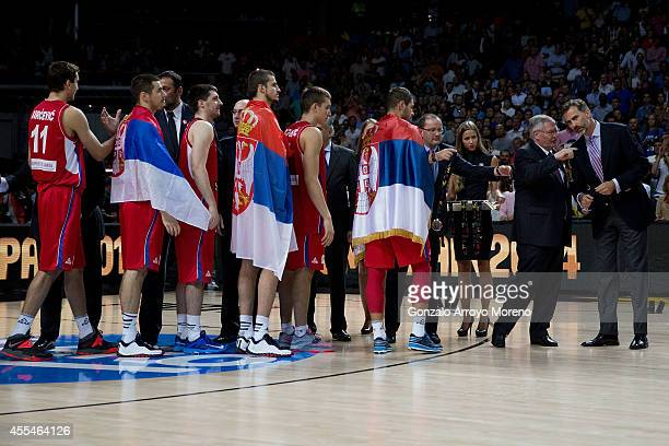 Fiba president Ivan Mainini inidcates Prince Felipe VI of Spain as Sebia players receive their medalls during the award ceremony after the 2014 FIBA...