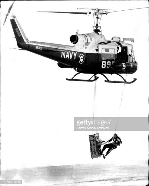 Fibber Archie plays the piano to the crowd whilst dangling from a Bell Iroquois Helicopter before the large crowdA spectacular Navy Air Day to mark...