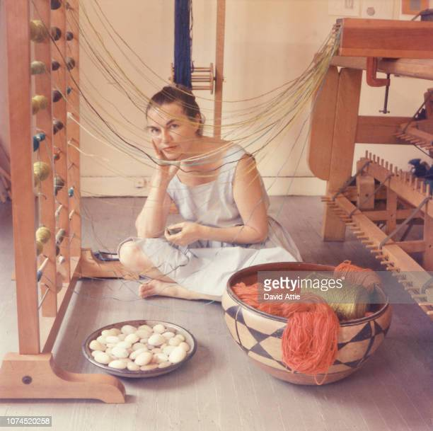 Fiber artist Lenore Tawney poses for a portrait in her studio at 27 Coenties Slip in 1958 in New York City New York