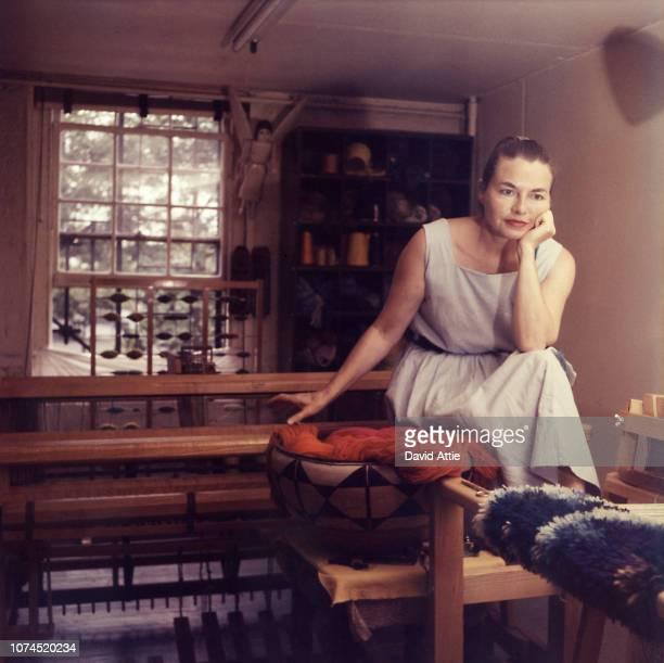 Fiber artist Lenore Tawney poses for a portrait in her studio in 1958 in New York City New York