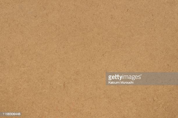 fiber brown paper textured background - marrone foto e immagini stock
