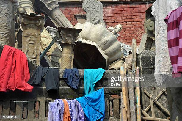 Fiber glass and plaster of Paris sculptures lay scattered in the potters district of Kumortuli, Kolkata ,India
