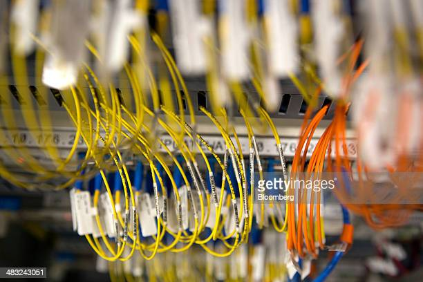 Fiber optic cables are connected to a server at Telefonos de Mexico SAB headquarters in Mexico City Mexico on Saturday April 5 2014 Telcel's Digital...