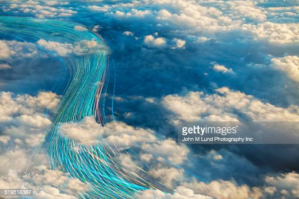 Fiber optic cables in cloudy sky