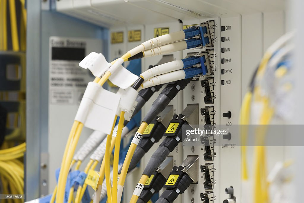 fiber optic datacenter with media converters and optical cables : Stock Photo