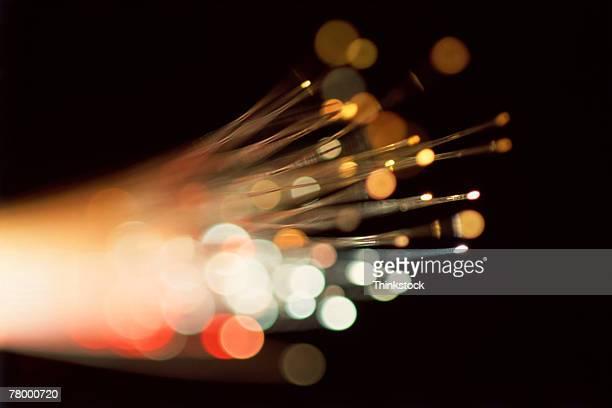 fiber optic strands - thinkstock stock-fotos und bilder