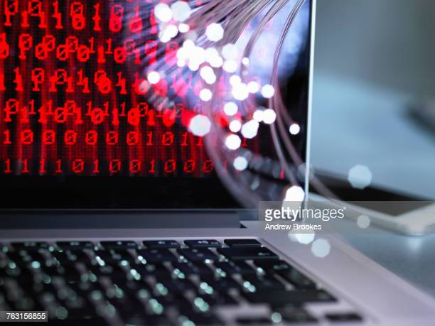 Fibre optics carrying data attacking a laptop computer which has a virus