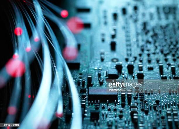 Fibre optics, hardware, circuit board in the background