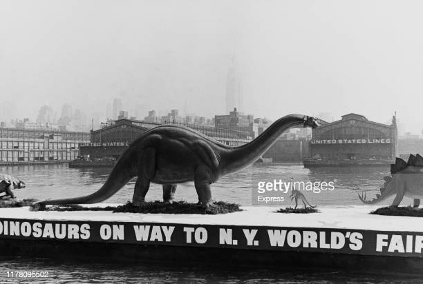 A fibreglass Brontosaurus makes its way past Manhattan to the New York World's Fair for the Sinclair Oil Corporation Dinoland exhibit 17th October...