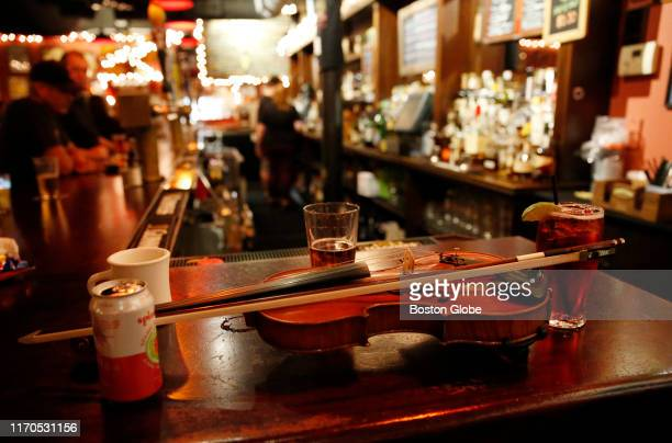 A fiddle rests on the bar during the Irish session at the Burren in Somerville MA on Sep 16 2019 Around Boston traditional Irish pubs are getting...
